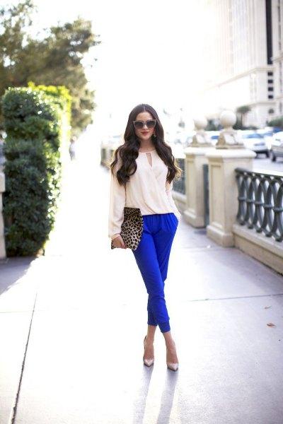 white blouse royal blue pants cheetah purse