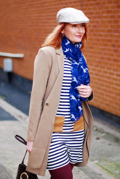 white flat cap with navy and white striped t shirt dress