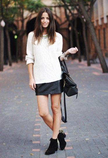 white knit sweater black leather mini skirt in winter
