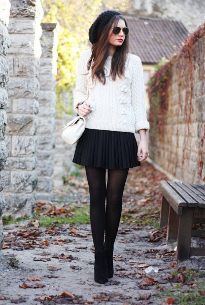 white knit sweater black pleaded mini skirt