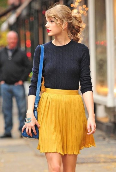 yellow pleaded mini skirt black sweater