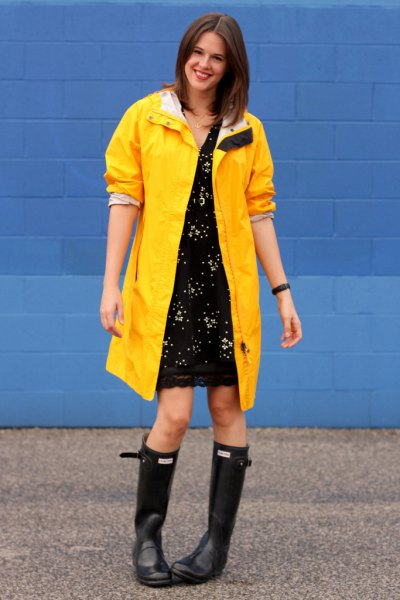 yellow raincoat black lace dress rain boots