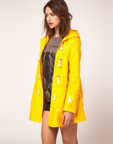 yellow raincoat grey knit sweater denim shorts