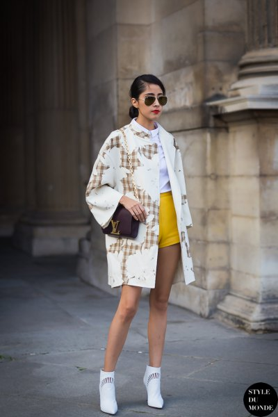 yellow shorts white print trench coat