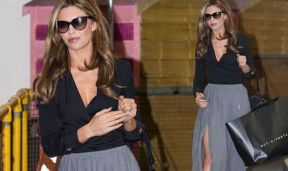 abbey clancy black wrap top grey maxi pleated skirt