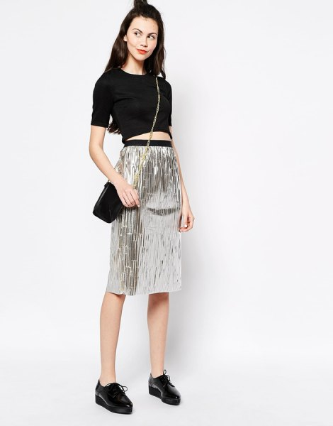 black cropped t shirt high waisted silver metallic skirt