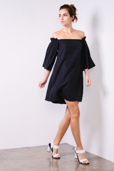 black dress with gathered sleeves