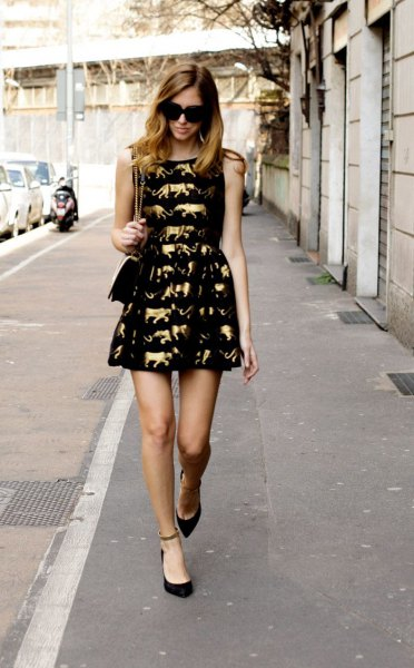 black fit and flare mini dress gold cute pattern