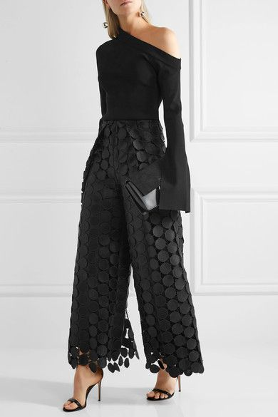 black lace pants over the one shoulder top