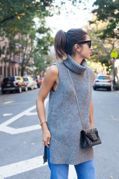 grey long sleeveless turtleneck sweater jeans