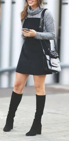 grey turtleneck sweater black pinafore dress