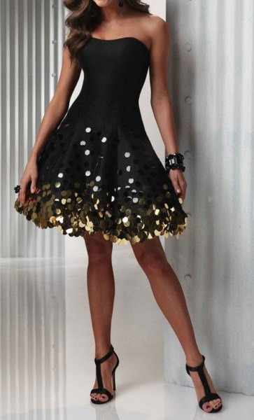 strapless black flare dress subtle gold element