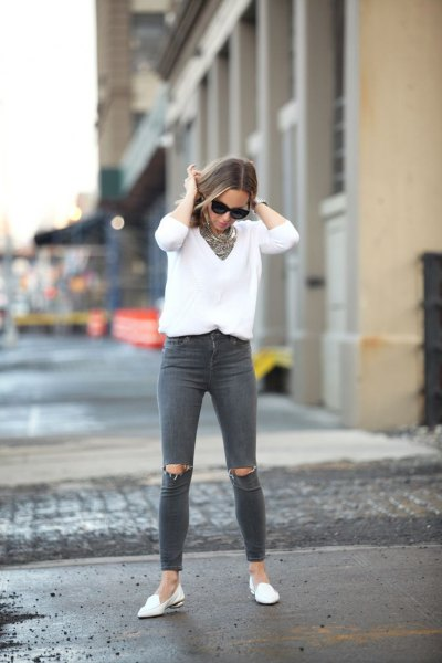 white v neck knit sweater grey ripped jeans