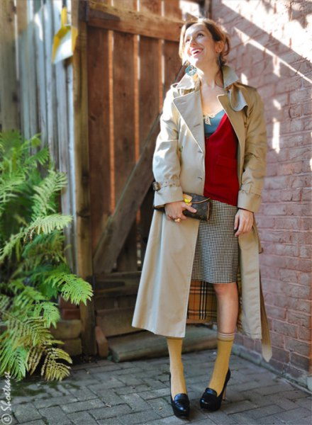 black loafers red sweater beige long trench coat