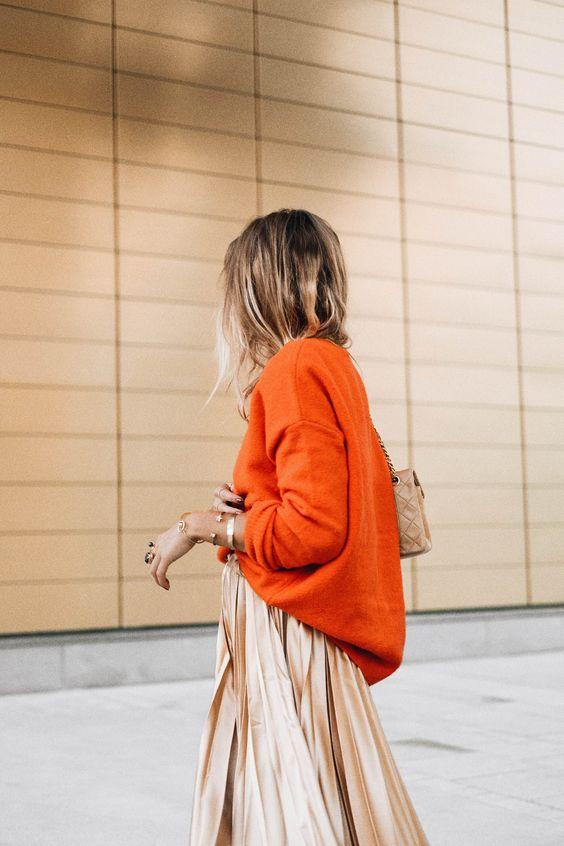 burnt orange sweater gold skirt