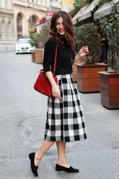 flared midi plaid skirt black sweater