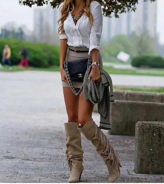 grey fringe knee high boots white shirt mini skirt