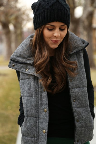 grey quilted tweed vest black knit hat