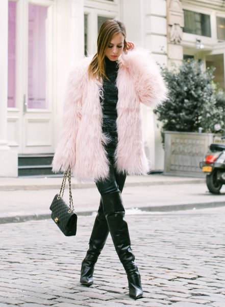 pink coat all black outfit