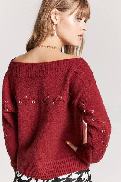 red boat neck sweater lace up details