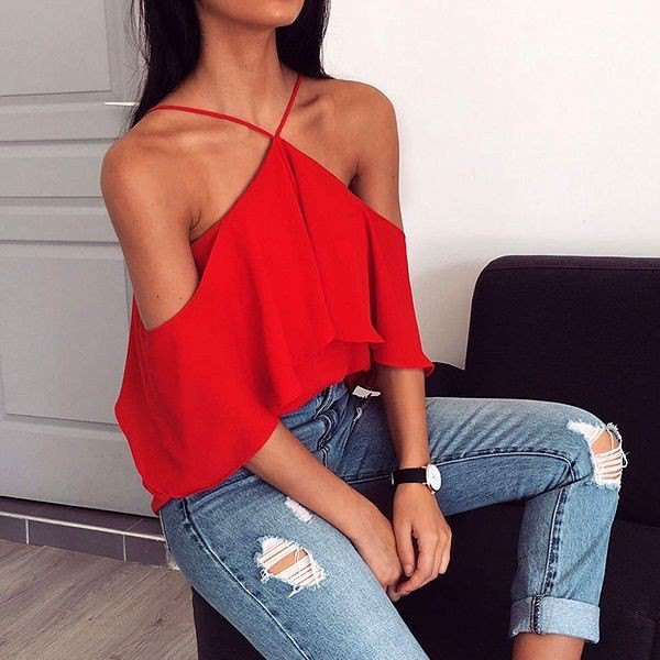 red off shoulder halter neck top ripped skinny jeans