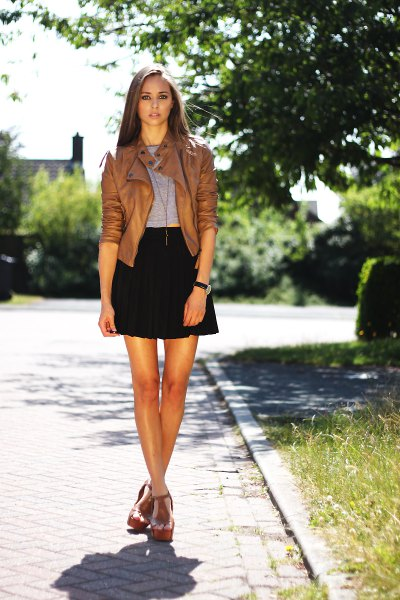 short brown leather jacket black high rise mini skater skirt