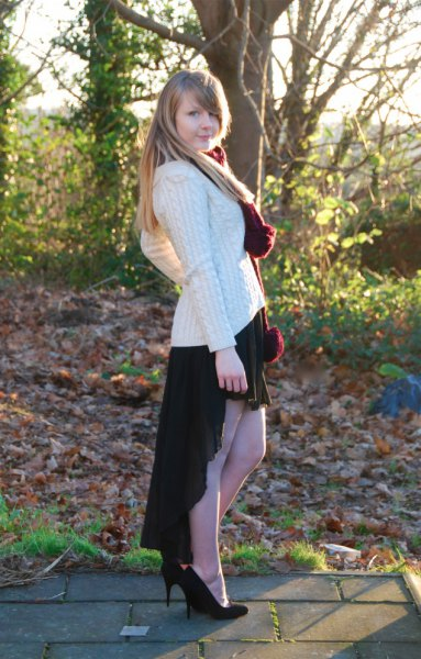 white cable knit chunky sweater black high low skirt