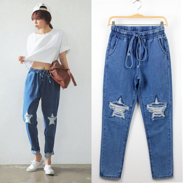 white cropped tee ripped baggy jeans