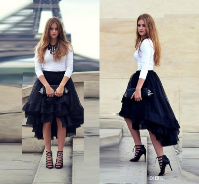 white form fitting sweatshirt black tulle high low skirt
