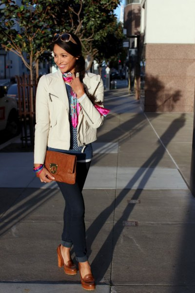 white leather jacket blue jeans brown heeled loafers