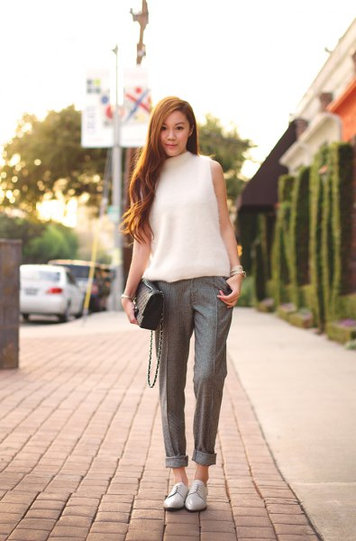 white mock neck sleeveless knit sweater cuffed tweed pants