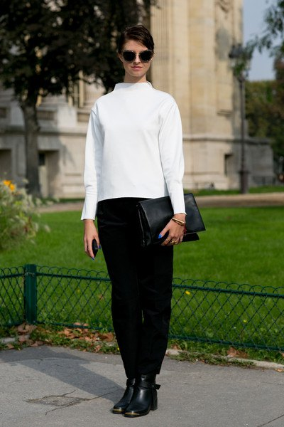 white mock neck sweater black pants