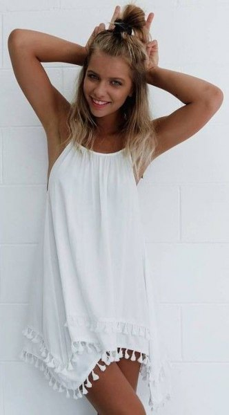 white sleeveless swing tassel dress