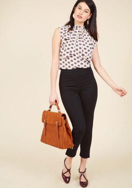 black and white printed sleeveless blouse with ponte pants