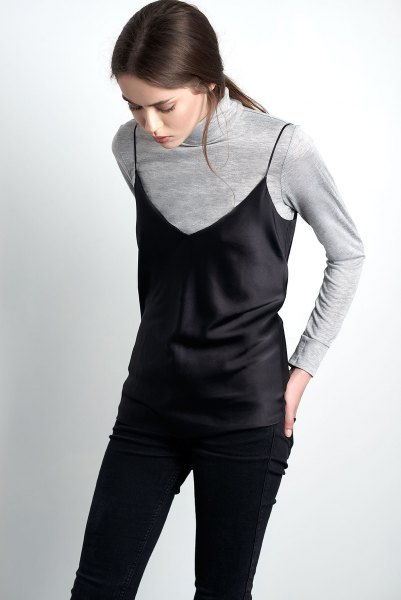 black camisole over grey turtleneck sweater