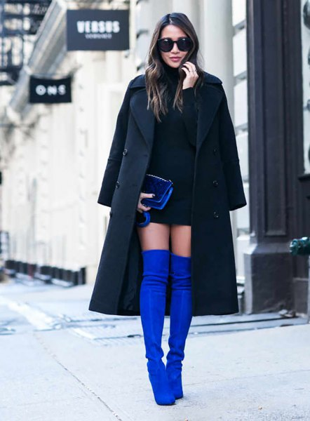 black long wool coat with royal blue over the knee velvet boots