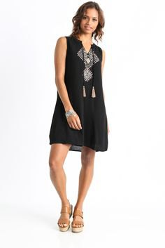 black sleeveless tribal shift dress