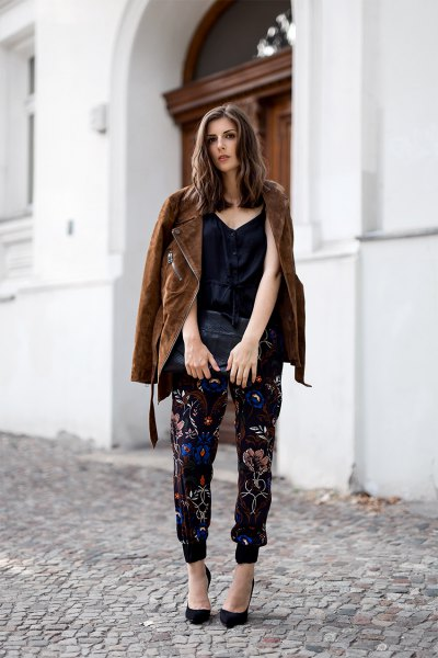 brown oversized suede jacket over black floral jogger pants
