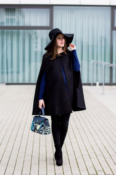 dark blue button up shirt black floppy hat