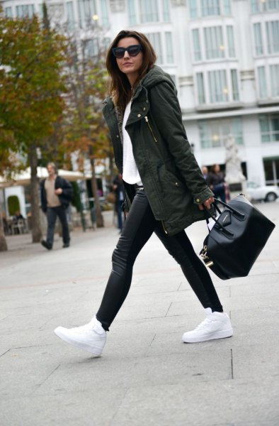 dark green parka jacket white sweatshirt black pants