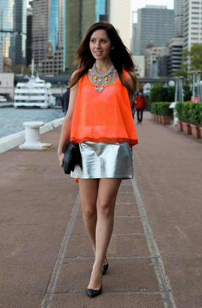 orange semi sheer chiffon sleeveless top silver metallic skirt
