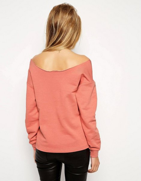 pink off the shoulder sweatshirt black leather pants