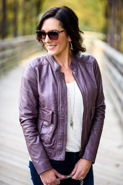 purple jacket white tee dark blue skinny jeans