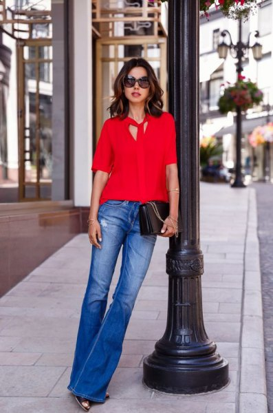 red tie neck blouse blue flared jeans