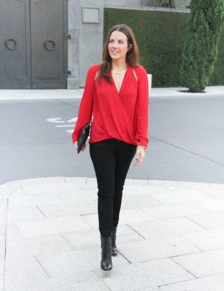 red wrap blouse black pants