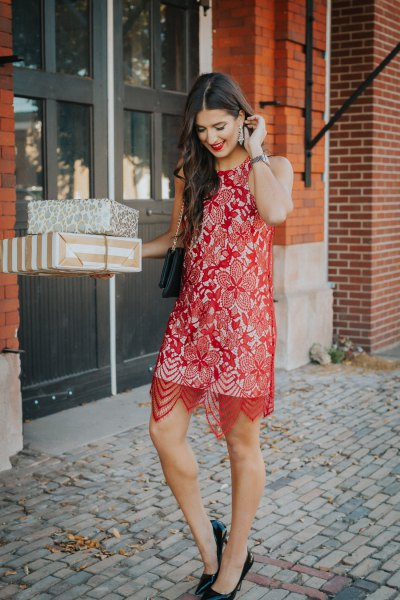 sheer red lace midi dress over white shift dress