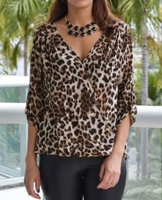 three quarter sleeve deep v neck leopard print blouse
