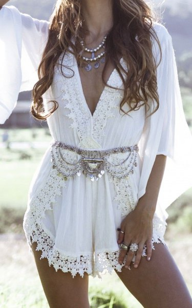 white boho style lace wrap mini dress with silver statement belt