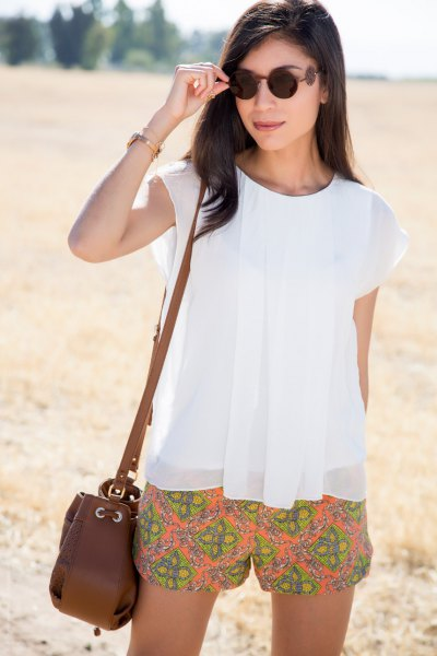 white chiffon cap sleeve top orange printed flowy shorts