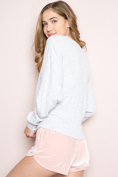 white crew neck sweatshirt pale pink velvet mini shorts